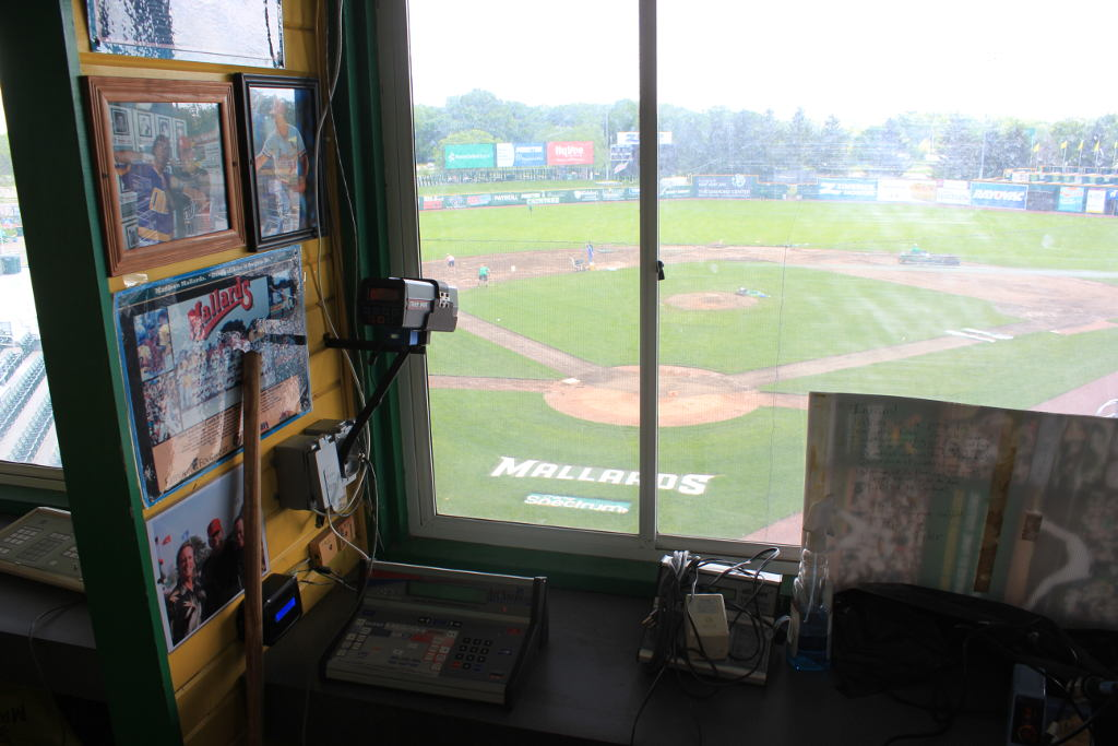 The view from the press box. The radar gun captures every pitch, the controller box is mounted on the wall, and the previous controller is wrapped up on the desk.